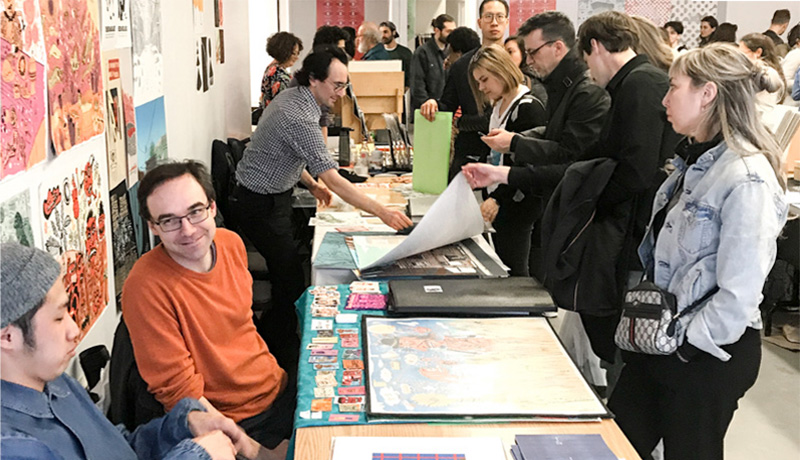 Artists selling posters at a fair